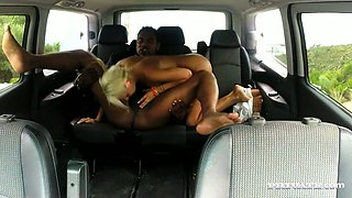 Slutty blonde admires a black guy with her blowjob skills in a car