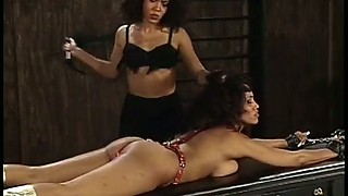Ebony dominatrix gets special pleasure from beating her slave