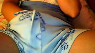 Teen girl masturbating on web cam while talking on a phone