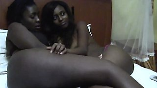 Lovely African lesbians Nisa and Anaya relaxes on the bed.