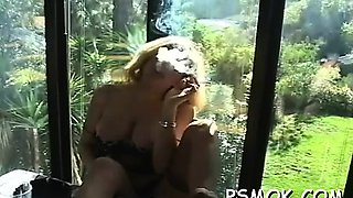 Elegant playgirl in lingerie likes to tease while smoking