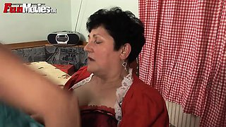 Older woman fucks Asian with a strap on