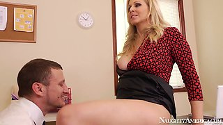 Spoiled busty clerk Julia Ann provides her boss with a titfuck in the office